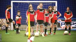 _90165993_girls_football_training_getty