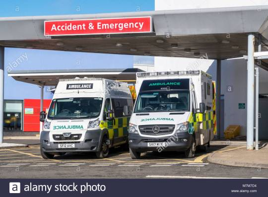 two-ambulances-parked-outside-the-accident-and-emergency-department-M7M7D4
